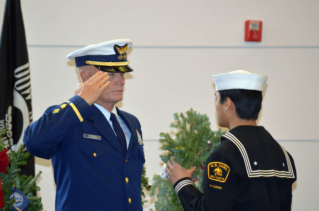 Celia Shortt Goodyear/Boulder City Review A U.S Coast Guardsman salutes a U.S. Naval Sea Cadet during the placement of ceremonial wreaths, symoblizing the passing of the torch to the younger gener ...