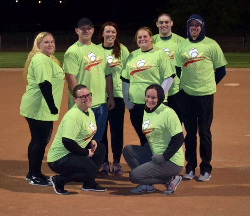 Kelly Lehr Wearing their championship shirts in Boulder City Parks and Recreation Department's adult coed softball league are members of the Boulder Dam Credit Union team, from left, Jenn Lusch, C ...