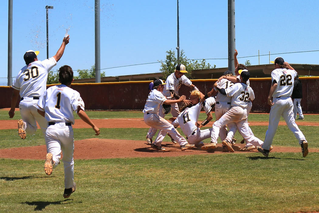 Laura Hubel/Boulder City Review From May: Members of Boulder City High School's baseball team celebrate winning their second consecutive state championship after narrowly defeating Spring Creek 8- ...