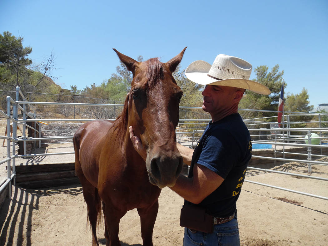Hali Bernstein Saylor/Boulder City Review From July: Boulder City Police officer Scott Pastore and his horse Odie, seen at his stable at the Boulder City Horseman's Association, make up the city's ...
