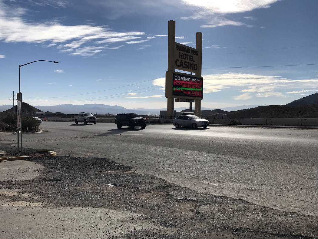 Hali Bernstein Saylor/Boulder City Review Cars pass by the sign for Railroad Pass on a portion of U.S. Highway 93/95 on Sunday that sits on an easement granted to the Nevada Department of Transpor ...