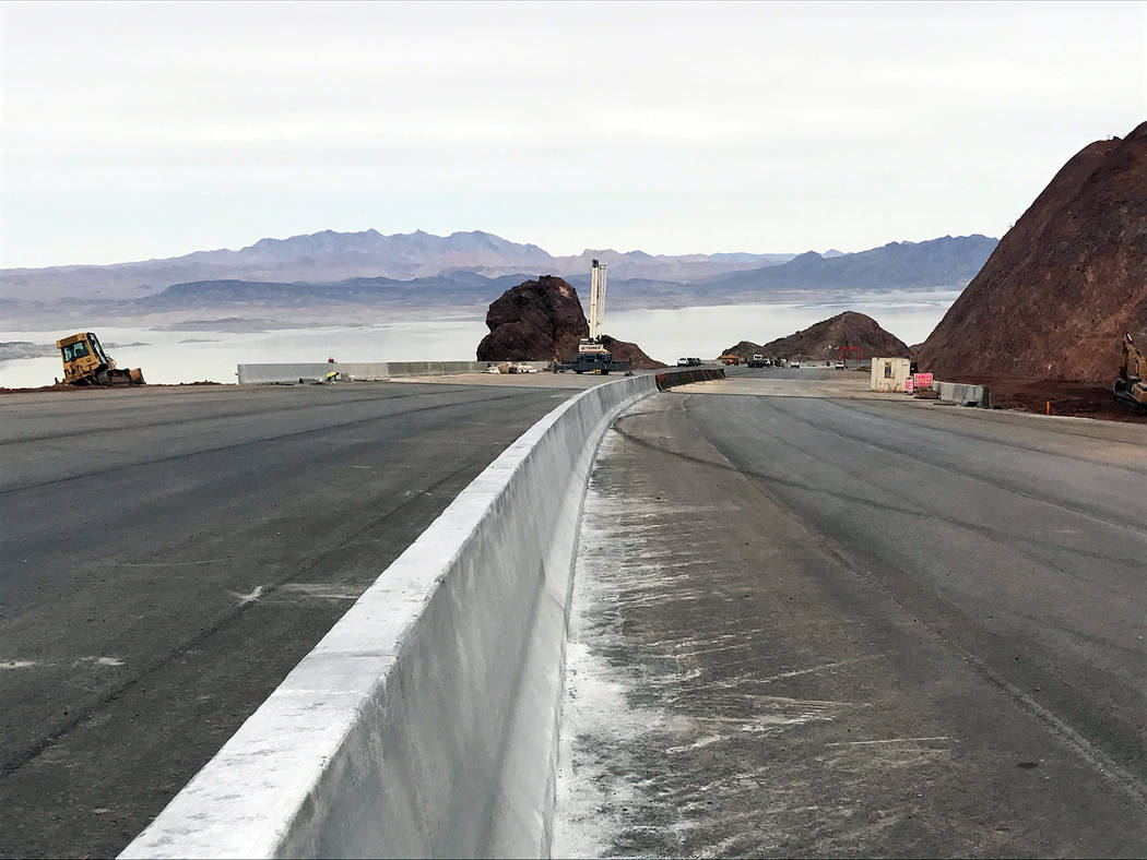 Regional Transportation Commission of Southern Nevada Lake Mead can be seen on Tuesday in the background from a stretch of the 12.5-mile stretch of Interstate 11 being built by the Regional Transp ...