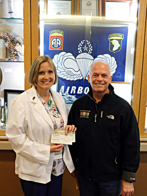 Courtesy photo Poppy Helgren, director of nursing at the Nevada State Veterans Home, accepts a $861 donation from Todd Ferguson of the Southern Nevada 7-Eleven Community Involvement group on Dec. 23.