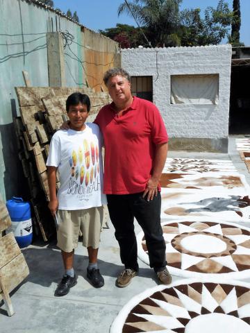 Peruvian designer Bautista shows off the rugs he created at Kevin Devine's factory near Lima, Peru. Photo courtesy Kevin Devine
