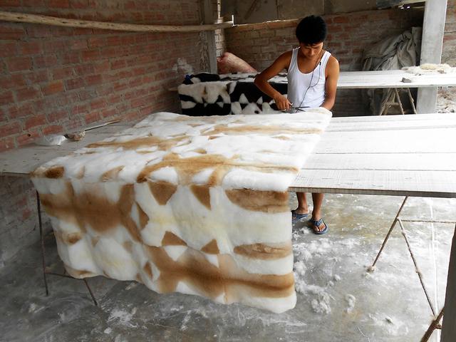 A worker sculpts an alpaca rug at a factory near Lima, Peru. Photo courtesy Kevin Devine
