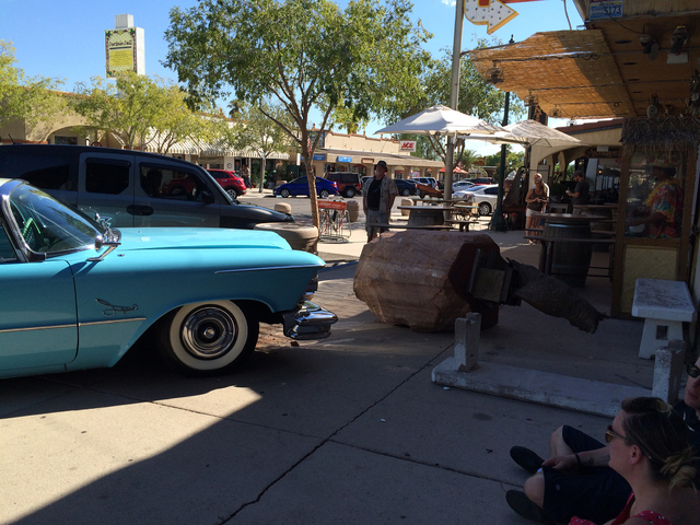 "Hali Bernstein Saylor/Boulder City Review A restored 1957 Chrysler Imperial sits on the side walk on Nevada Way after the driver crashed into the ""Monumental Professor"" sculpture Saturday. The cra ..."