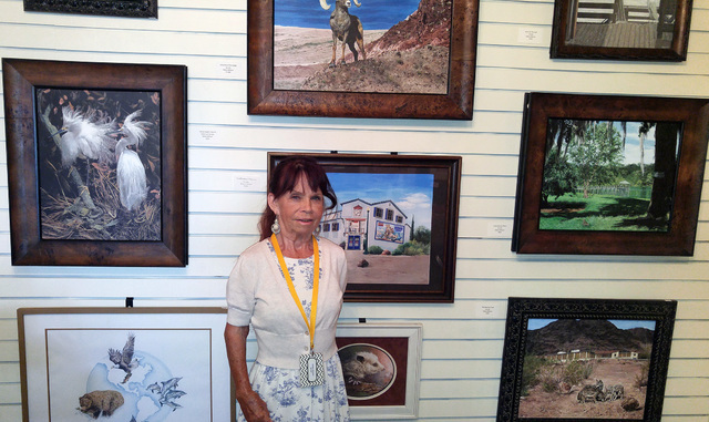 The Boulder City Art Guild held a reception Sunday, July 17, 2016, for Debra Wilson, July's featured artist, whose photorealistic wildlife and landscape paintings will be on display all month long ...