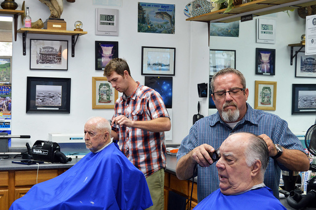 Max Lancaster/Boulder City Review. Josh Johnson and his father Frank Freer cut the hair of Jack Wooley and Bob Gossett at Frank's Barber Shop on Nevada Way. The father and son duo have been cutt ...