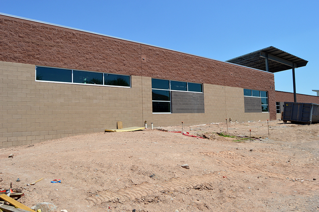 Windows are being attached to the frames in one of the more complete areas of the new 41,000-square-foot building under construction at Boulder City High School. Max Lancaster/Boulder City Review