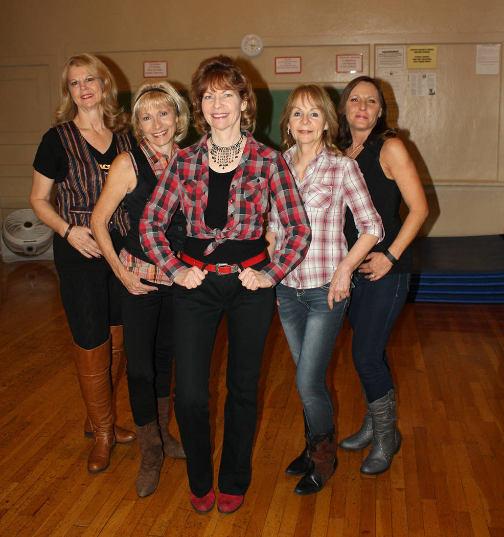 Courtesy photo Lynn St. Pierre, center, leads local line dancing classes and has arranged for quarterly social events. A line dance social will be held Saturday at the Department of Water and Powe ...