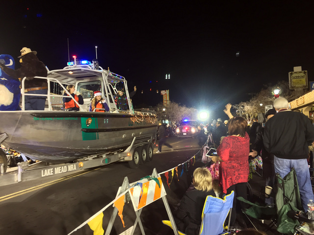 File photo Smokey Bear waved to parade watchers during Santa's Electric Night Parade in 2015. The festive procession returns at 4:30 p.m. Saturday to historic downtown Boulder City.