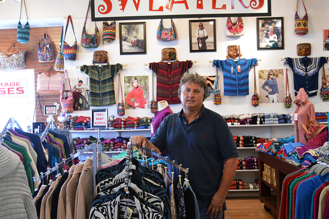 Alpaca Imports owner Kevin Devine poses in front of items made from 100 percent alpaca wool. Devine makes two or three trips a year to Peru where he and his business partner, Welden Jeffreys, fund ...