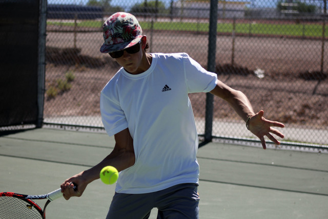 Robert Vendettoli/Boulder City Review Boulder City High School junior Andre Pappas returns a forehand shot to Sam Oberto during a practice session Tuesday at the school. The team's season opens Au ...