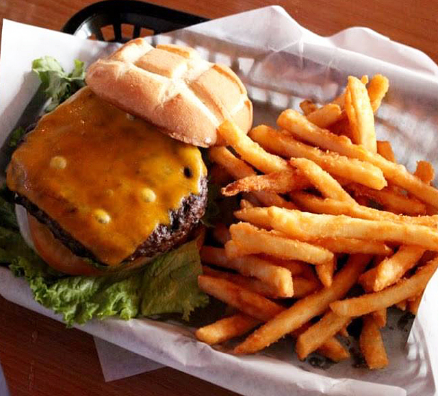 Jack's Place serves Jack's burger topped with lettuce, tomato, onion and Thousand Island dressing. Courtesy Jack's Place
