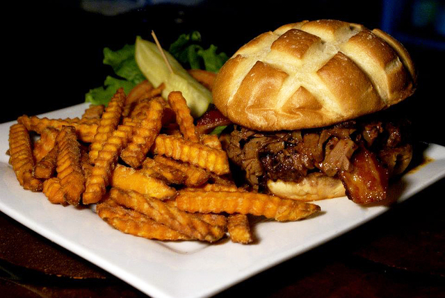 The Dillinger burger topped with bacon and brisket is the signature burger at The Dillinger Food and Drinkery. Courtesy The Dillinger