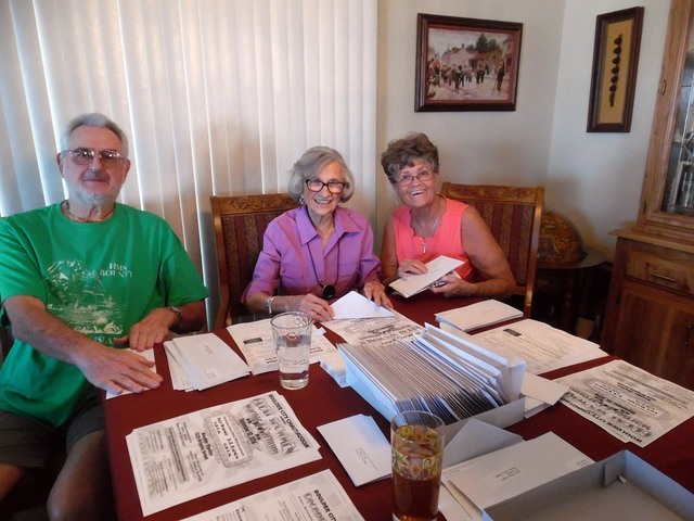 """With the Boulder City Chautauqua five weeks away, Jay Richey, Sara Denton, center, and Sue McCullough prepare to send out fliers to previous attendees. This year's presentation, """"Great Showmen,"""" i ..."""