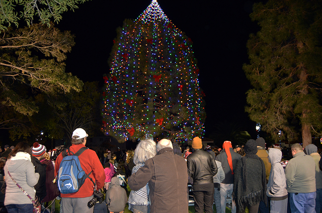 Max Lancaster/Boulder City Review  Residents admire the newly lit community Christmas tree during the Christmas tree lighting at Frank Crowe Park on Friday. Those attending were also treated to fr ...