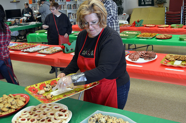 Max Lancaster/Boulder City Review  Cookie Grimberg plates some tasty treats at the Faith Christian Church cookie sale on Dec. 3. The event was well-received with a number of Boulder City residents ...