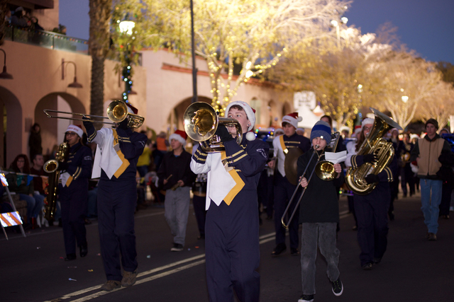 Noel Kanaley/Boulder City Review Boulder City High School's marching band heads down Nevada Way during Santa's Electric Night Parade on Saturday.
