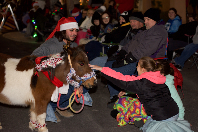 Noel Kanaley/Boulder City Review Spectators lining Nevada Way has a chance to get up close and personal with a miniature horse brought by Marlene Myers and the Boulder City Horseman's Association  ...