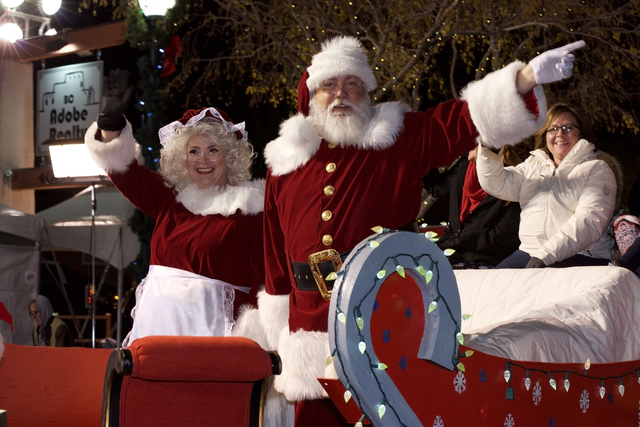 Noel Kanaley/Boulder City Review Santa and Mrs. Claus wave to the crowd as they make their appearance during Santa's Electric Night Parade on Saturday.