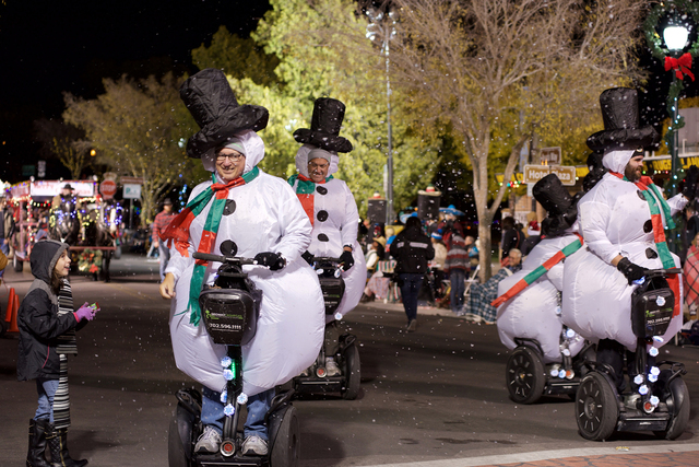Noel Kanaley/Boulder City Review A group of snowmen traded in their more traditional winter rides for Segways as part of Segway Las Vegas's entry in Santa's Electric Night Parade on Saturday.