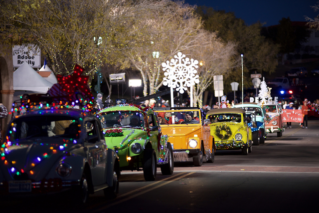 Noel Kanaley/Boulder City Review Vintage Friends and Families with Vintage Volkswagens rolled out their holiday finest for Santa's Electric Night Parade on Saturday.