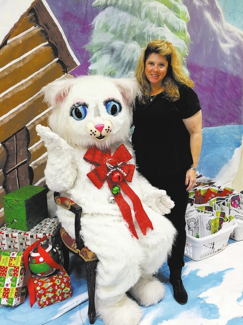 Hali Bernstein Saylor/Boulder City Review Jill Rowland-Lagan, CEO of the Boulder City Chamber of Commerces, welcomes Jingle Cat to Santa's Picture Party on Saturday, Dec. 3, 2016, held at the Boul ...