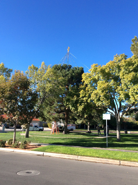 Hali Bernstein Saylor/Boulder City Review City electrical workers created a new cone-shaped topper for the Christmas tree in Frank Crowe Park. At night, when lit, it will give the appearance of a  ...