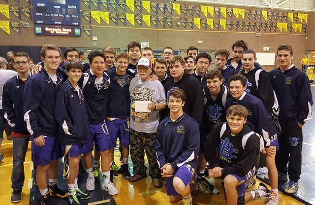 Courtesy photo Members of Boulder City High School's wrestling team gather around longtime wrestling coach Chuck Brown, who died Friday, Jan. 20, 2017.