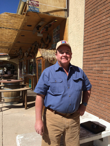 Gregory Hall, a retired FBI special agent and former U.S. Army paratrooper assigned to the 82nd Airborne Division, stands outside the World Famous Coffee Cup. The Boulder City resident was challen ...