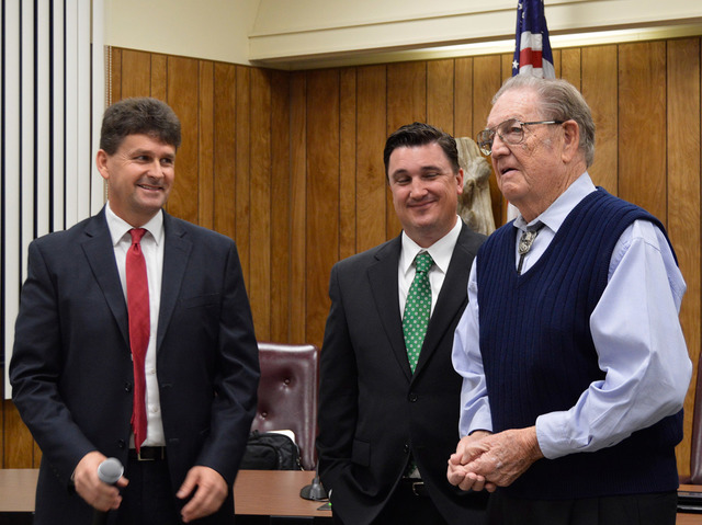 Max Lancaster/Boulder City Review Bill Andrews Award winner Joe Rowe, right, is congratulated by Mayor Rod Woodbury, left, and Councilman Rich Shuman. Rowe was presented with the award during the  ...