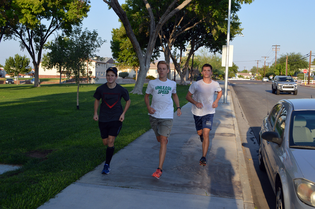 Boulder City High School cross-country runners John Krausman, from left, Tyler Campbell and Braden Klouse practice along the city's streets in preparation for this coming season. Photo courtesy Ca ...