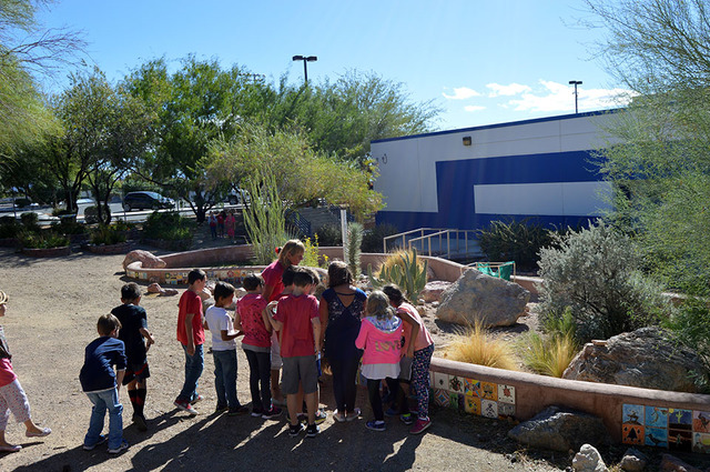 Max Lancaster/Boulder City Review Third-grade teacher Sara Carroll tours the tortoise habitat with her class at King Elementary School on Monday. The kids did not get to see the school's 25-year-o ...