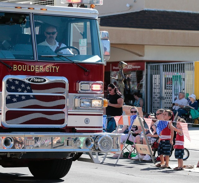 Two young boys watch a firetruck drive past during the 68th annual Damboree parade in Boulder City on Monday, July 4, 2016. Donavon Lockett/Boulder City Review