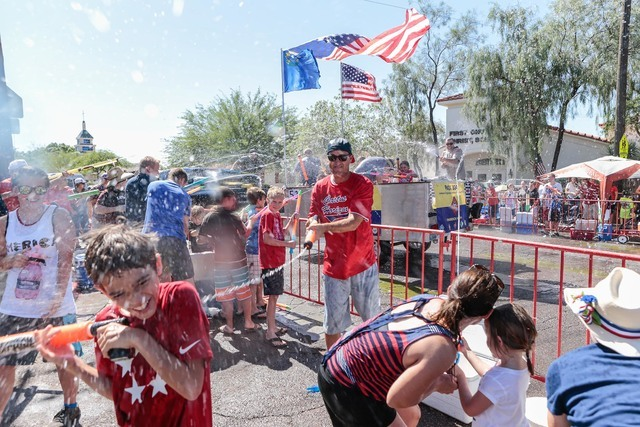 Spectators participate in a water fight in the water zone area of the 68th annual Damboree parade in Boulder City on Monday, July 4, 2016. Donavon Lockett/Boulder City Review