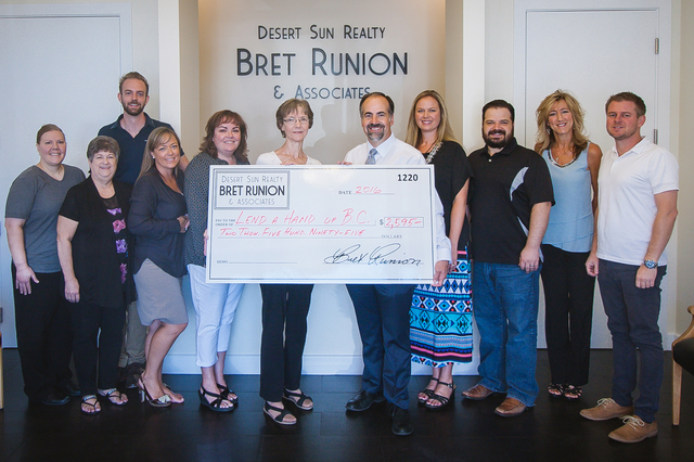 Courtesy photo Employees at Desert Sun Realty recently donated $2,595 to Lend A Hand. Staff members agreed to make a monthly contribution to various community causes based on the number of closing ...