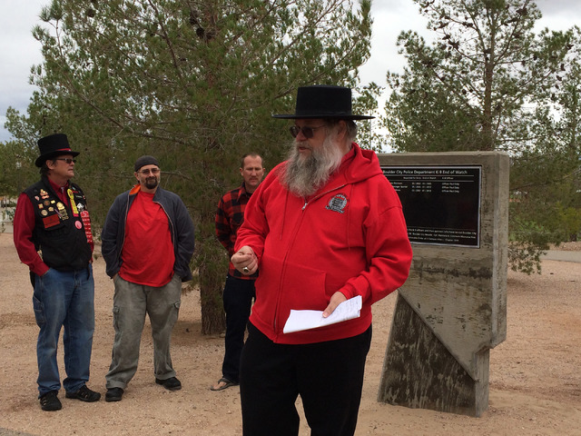 Hali Bernstein Saylor/Boulder City Review Mark Hall-Patton, right, a past humbug of the Queho Posse chapter of E Clampus Vitus, offers a brief history of police K-9 units before a monument marking ...