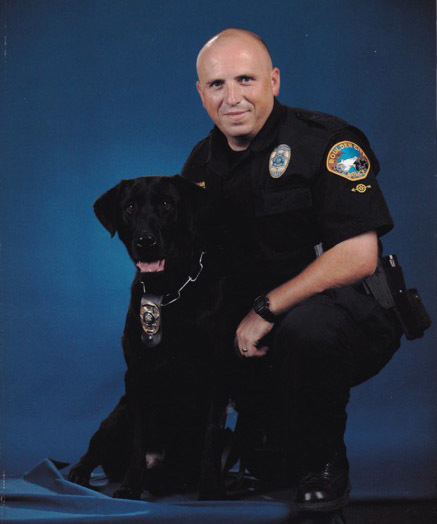 Courtesy photo Boulder City Police Department officer Alan Nutzman is shown with his K-9 partner, Charlie. The black Labrador retired Nov. 21 because of health issues.
