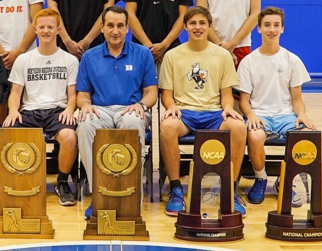 Boulder City High School students Tanner Montgomery, left, Carson Balistere, second from right, and Teddy Lobkowicz, far right, post with Duke University's Coach Mike Krzyzewski during their summe ...