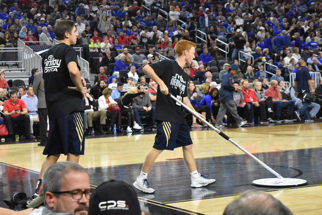 Robert Vendettoli/Boulder City Review Boulder City High School basketball players Carson Balistere, left, and Tanner Montgomery helped keep the court clean and provide water to the players during  ...