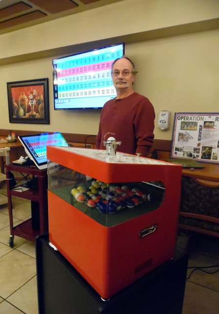 Hali Bernstein Saylor/Boulder City Review Tim Murray, veterans chairman for the Nevada State Elks Association, gets ready to call bingo for residents at the Nevada State Veterans Home using the ne ...