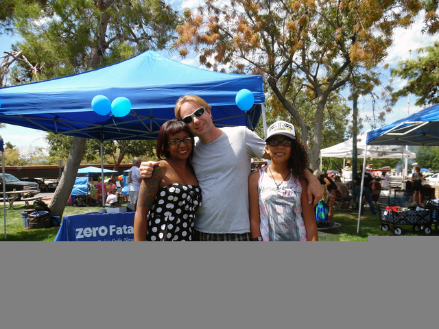 Hunter Terry/Boulder City Review Cindy, Burton and Ely Kelly, from left, moved to Boulder City just a few months ago and said they absolutely love it. They said they were thrilled with the Fall Fa ...