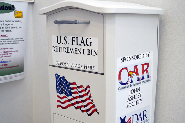 Max Lancaster/Boulder City Review The United States Flag retirement bin located at the Boulder City Library can be used to properly dispose of old flags. The bin was donated by the Daughters of th ...