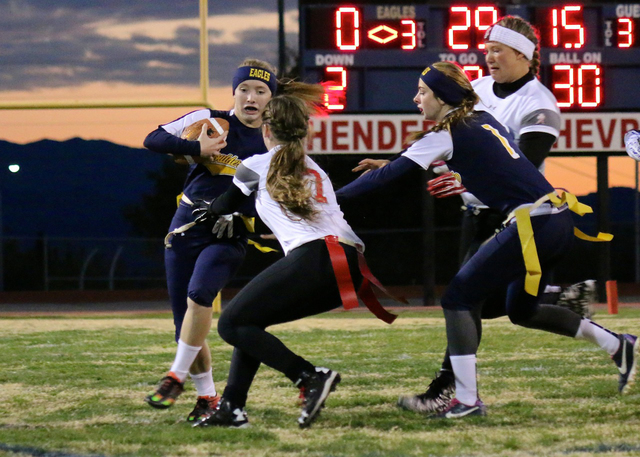 Laura Hubel/Boulder City Review Boulder City High School's new flag football quarterback, sophomore Taylor Tenney, left, gains some yards as senior Kenadee Bailey, second from right, tries to get  ...