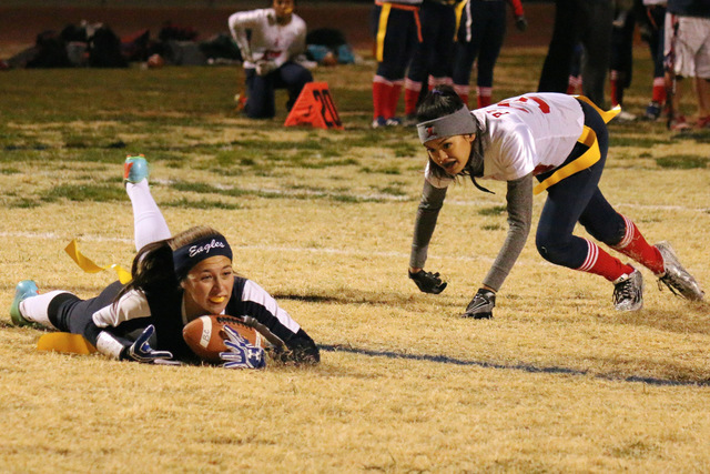 Laura Hubel/Boulder City Review Boulder City High School junior Nikki Meleo, left, dodged the hands of a Liberty player only to lose her footing and go down with her flags intact during their home ...