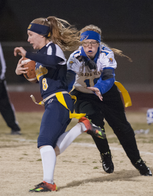 Steve Andrascik/Boulder City Review Boulder City High School junior Taylor Tenney evades a tackle by Moapa Valley defender in first-half action at home. Tenney rushed for 113 yards and one touchdo ...