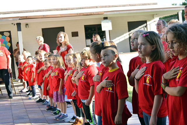 Max Lancaster/Boulder City Review Julian Vargas, 6, fourth from right, and the other students of Grace Christian Academy hold their hands over their hearts during the Pledge of Allegiance. The stu ...