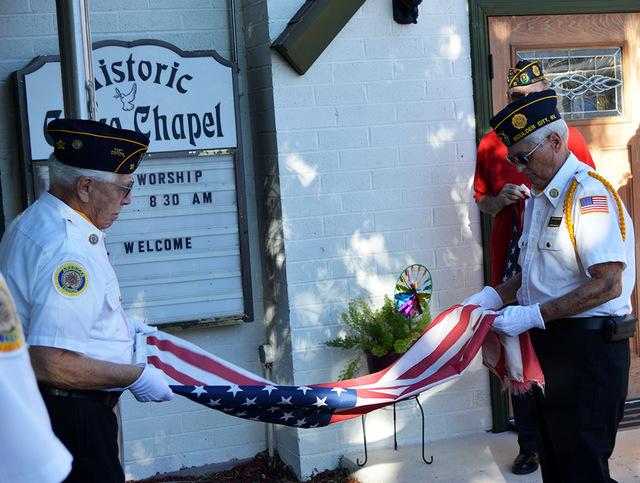 Max Lancaster/ Boulder City Review American Legion, Post 31, members Ron Effertz, left, and David Mulligan retire Grace Christian Academy's American flag Friday during the school's flag retirement ...