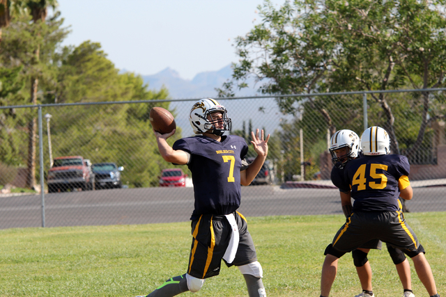 Boulder City High's Taylor Hatchel, a newcomer who transferred from Legacy Christian Academy in Frisco, Texas, works on his passing skills during practice Tuesday in preparation for Friday's s ...